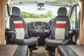 fully adjustable upholstered driver and passenger seats with twin armrests3